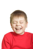 Laugh. Ing boy in red isolated over white Royalty Free Stock Photo