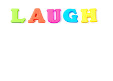 Laugh. Colored letters spelling the word Laugh Royalty Free Stock Photography