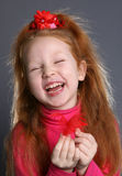 The laugh. Laughing little girl with feather portrait Stock Photography