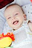 Laugh of baby boy. Happy baby boy laying in pram Royalty Free Stock Image
