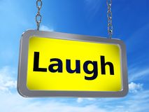 Laugh on billboard. Laugh on yellow light box billboard on blue sky background Stock Images