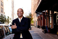 Laugh Business Man. A happy business man, downtown in a city Stock Image