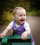 Laugh of happy little baby girl. Playing outdoors Stock Photography