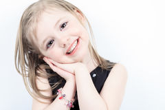Laugh a little girl at the studio shooting Stock Images
