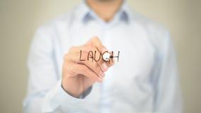 Laugh , Man writing on transparent screen Royalty Free Stock Photos