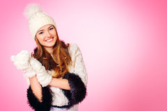Laugh natural. Joyful girl in warm knitted clothing smiling at camera. Beauty, fashion. Winter lifestyle. Copy space Royalty Free Stock Image
