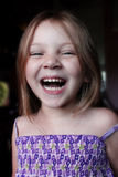Laugh out Loud. A Very happy 5 year old girl, laughing out loud Royalty Free Stock Image