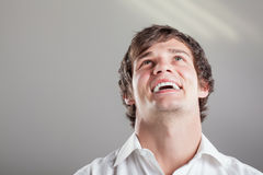 Laugh out loud. Portrait of a cute caucasian boy in a white collar shirt with his head tilted skywards laughing out loud Stock Images