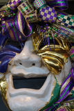 Laugh. Smiling Mardi Gras mask in New Orleans stock images