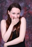 Laugh at somebody, mobbing. Young woman in black dress laughing at somebody Stock Photos