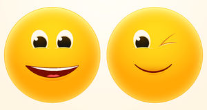 Laugh and wink smileys Stock Images