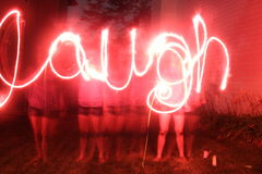 Laugh. The word laugh spelled with sparklers Stock Images