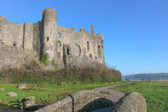 Laugharne Castle, Wales. Laugharne, Wales - December 2014: Laugharne Castle, dating back to the 13th century. The poet Dylan Thomas boathouse and Laugharne Stock Photo
