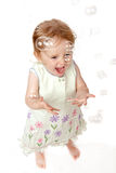 Laughing 2 Year Old Girl Catching Bubbles Royalty Free Stock Photography