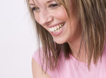 Laughing. A beautiful young woman laughing Stock Photo