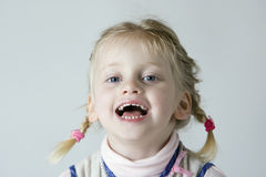 Laughing. Young Girl having fun with white background Royalty Free Stock Images