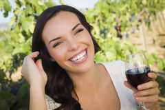 Laughing Adult Woman Enjoying A Glass of Wine in Vineyard Royalty Free Stock Photos