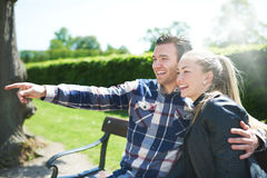 Laughing affectionate couple in the park Stock Images