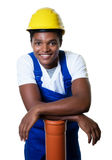Laughing african american construction worker with pipe Stock Image