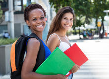 Laughing african american female student with caucasian girlfriend Stock Photography
