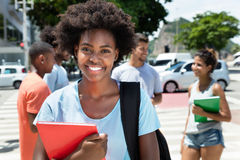 Laughing african american female student with group of friends Stock Images