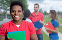 Laughing african american male student with stubble and multiethnic friends Royalty Free Stock Photo