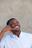 Laughing african american man with call me gesture Stock Photography