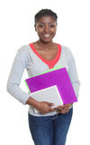 Laughing african american student with paperwork Royalty Free Stock Photography