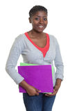 Laughing african american student with paperwork Stock Photo