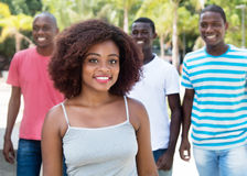 Laughing african american woman with friends from Africa Royalty Free Stock Images