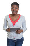 Laughing african american woman with tablet Stock Image