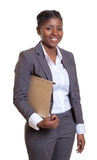 Laughing african business woman with file. On an isolated white background for cut out Stock Image