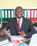 Laughing african businessman at his office Royalty Free Stock Photography