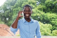 Laughing african businessman with mobile phone Royalty Free Stock Image