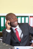 Laughing african businessman at phone Stock Photos