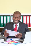 Laughing african businessman reading a message Royalty Free Stock Photography
