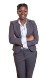 Laughing african businesswoman with crossed arms Royalty Free Stock Image