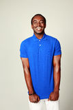 Laughing african man in blue t-shirt standing Stock Photos