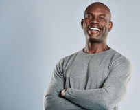Laughing African man in gray shirt with copy space Royalty Free Stock Photos