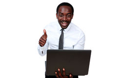 Laughing african man holding laptop Stock Image