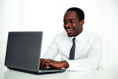 Laughing african man using laptop Royalty Free Stock Photo
