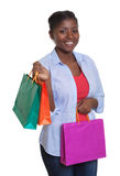 Laughing african woman with shopping bags Stock Photography