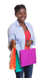 Laughing african woman showing her shopping bags Stock Image