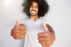 Laughing afro man with two thumbs up Stock Photography