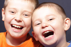 Laughing aloud. Two brothers laughing aloud closeup portrait Royalty Free Stock Images