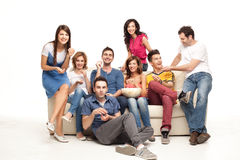 Laughing amusing couch friends Stock Images