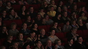 Laughing applauding people in movie hall stock footage