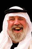 Laughing Arab. A laughing man wearing an Arabic headdress stock photography