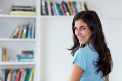 Laughing arabic woman with long dark hair royalty free stock photos