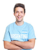 Laughing argentinian sports fan with crossed arms Royalty Free Stock Images